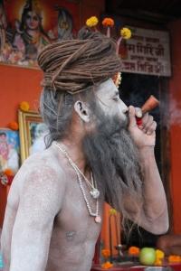 Naga sadhu with his chillum