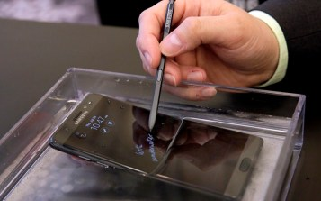In this July 28, 2016, photo, a submerged Galaxy Note 7 is demonstrated in New York. Samsung releases an update to its jumbo smartphone and virtual-reality headset, mostly with enhancements rather than anything revolutionary during a preview of Samsung products. (AP Photo/Richard Drew)