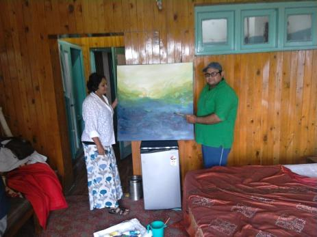 artists-at-the-residency-showcasing-a-painting