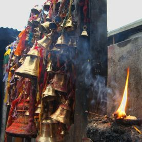 Smoking_candles_at_muktinath_temple,_nepal
